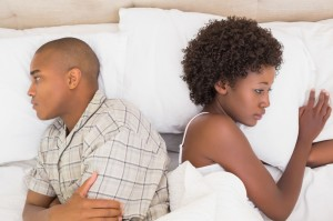 bigstock-Unhappy-couple-lying-on-bed-no-69332407-1024x682