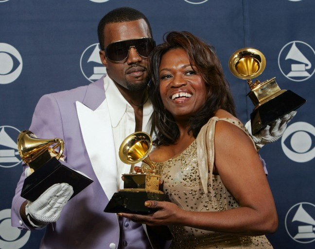 Kanye West  and his mother Donda hold his three awards backstage at the 48th Annual Grammy Awards on Wednesday, Feb. 8, 2006, in Los Angeles. West won for best rap album, solo and song. (AP Photo/Reed Saxon)